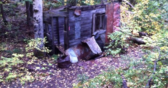 An old hut in the woods on Red Mountain in the BC Fall