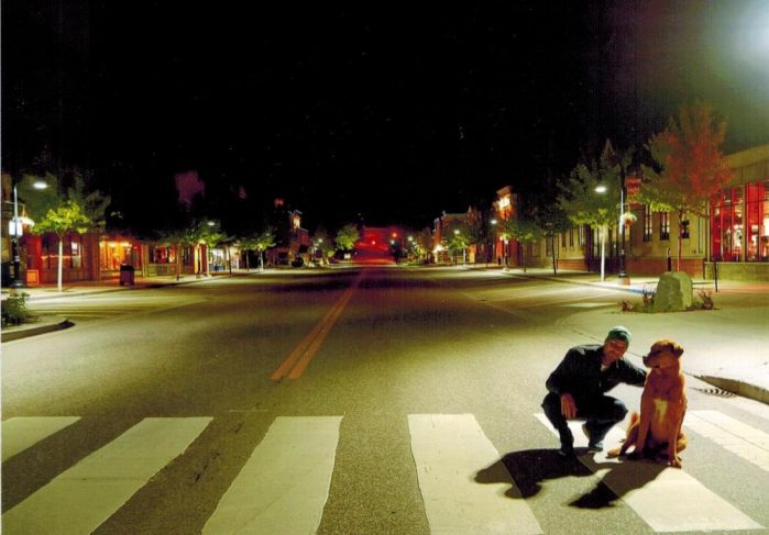 Martin and Hank at night on the main street of Rossland BC outside Ferraro Foods