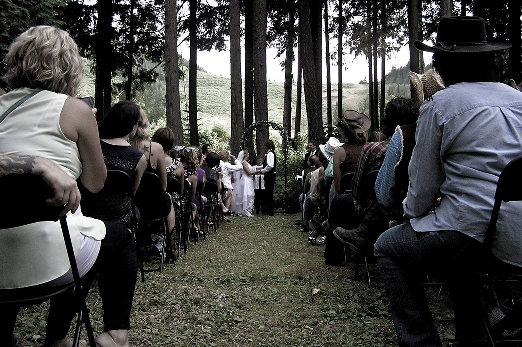Outdoor wedding vows in the forest at the Rams Head Inn at Red Mountain